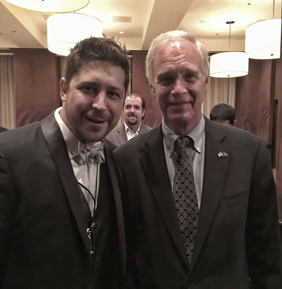 Senator Ron Johnson poses with director Aaron Biebert at the North American premier of A Billion Lives.