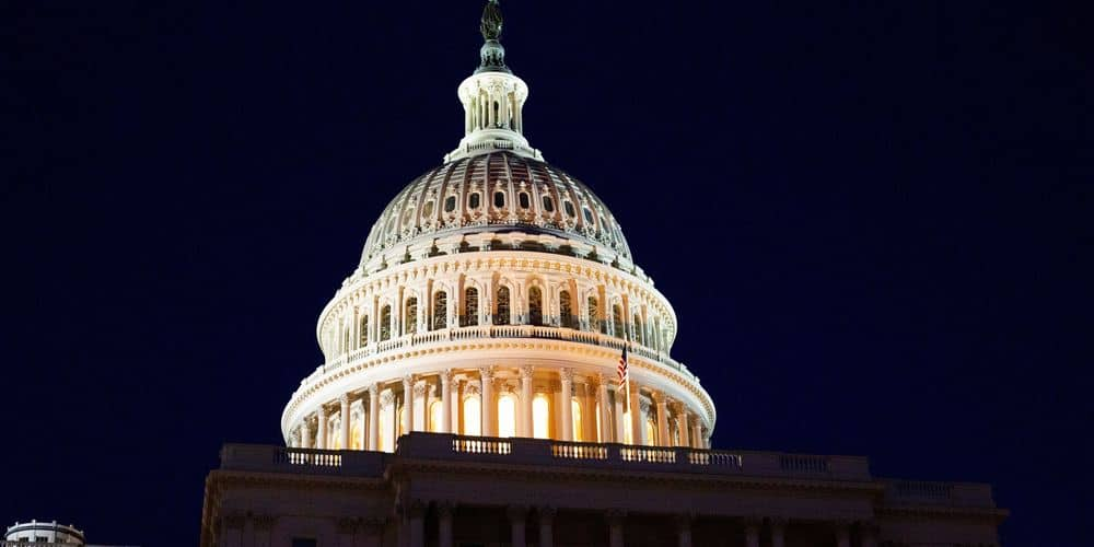 The dome of the US Capitol Building against the night sky