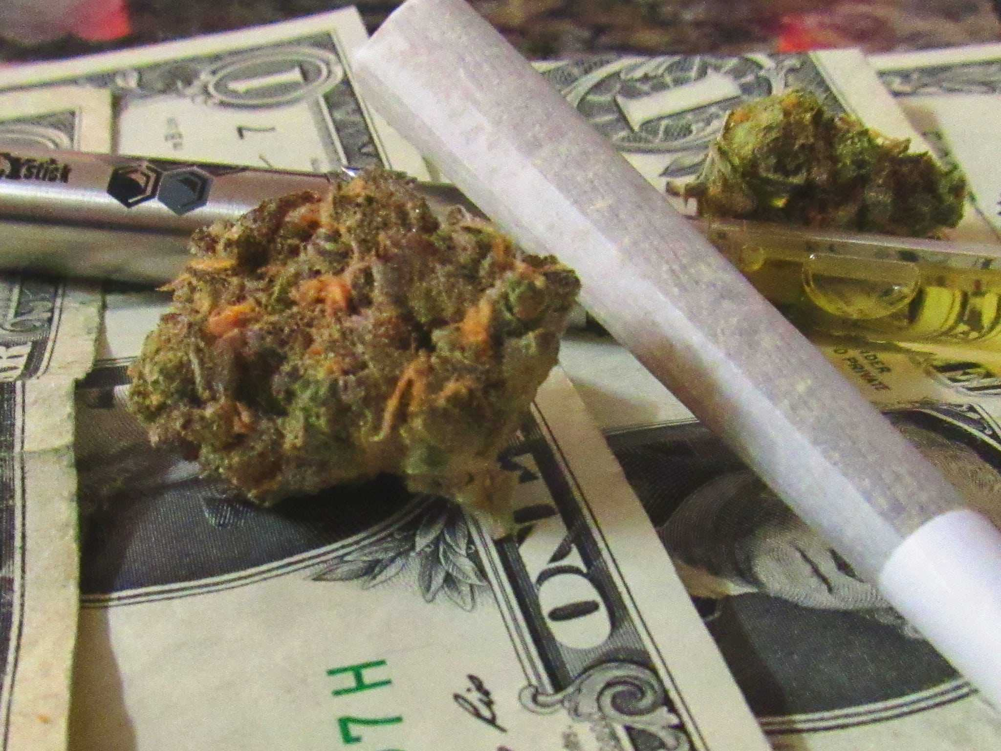 CBD and marijuana products on top of cash