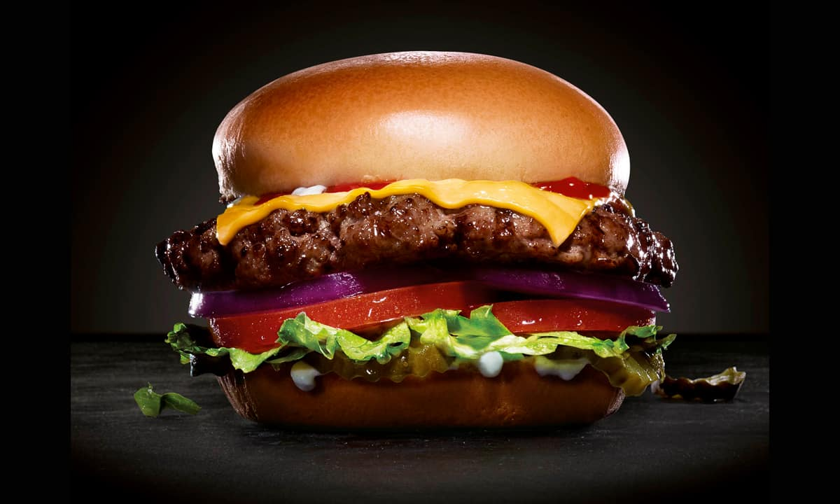 Cheeseburger on black background