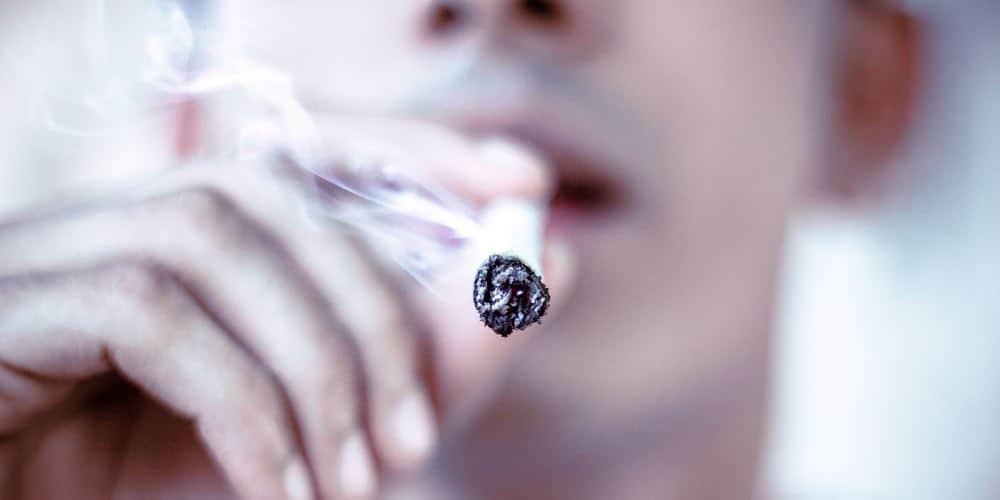 close up of man inhaling