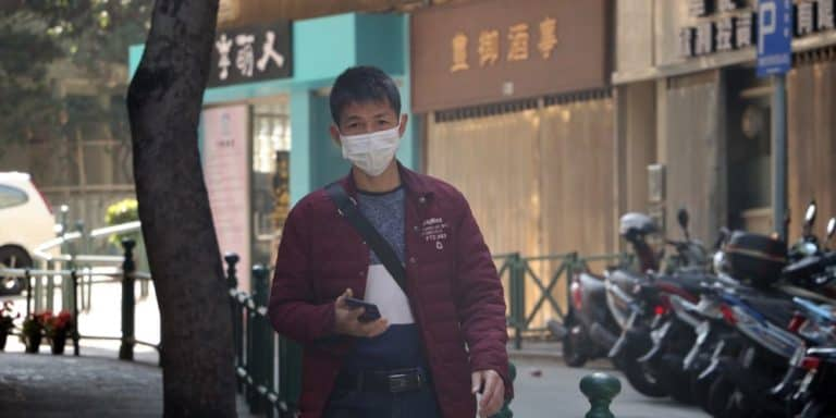 a man wears a surgical mask to protect against diseases like coronavirus