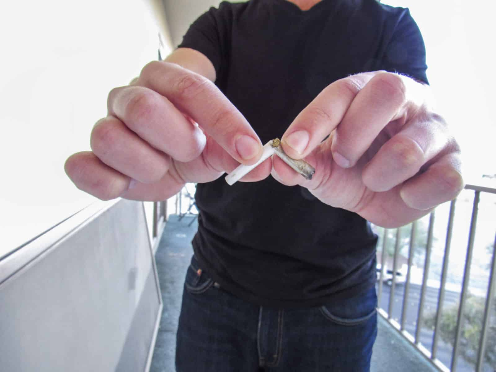 Man holding broken joint