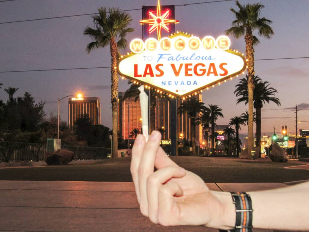 Marijuana in front of Welcome to Las Vegas sign