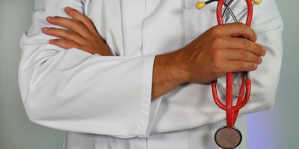 an image of a person dressed like a doctor holding a stethoscope