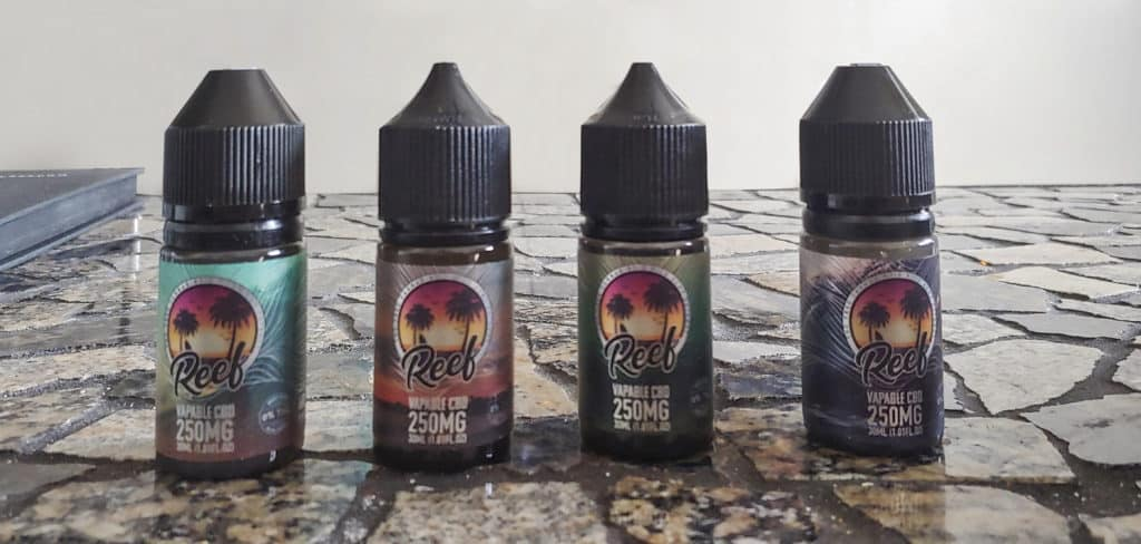 Reef CBD vape juice flavors on table
