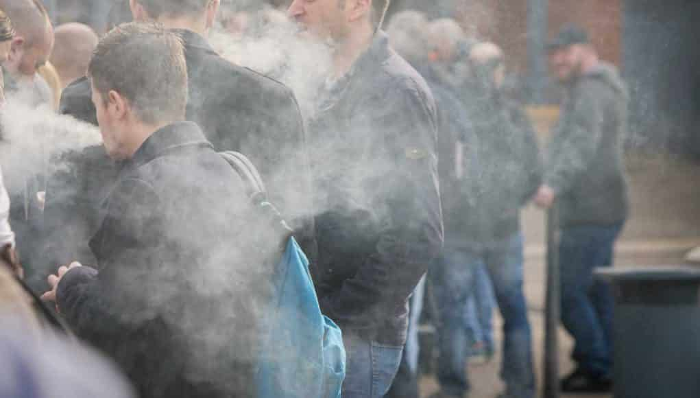 Group of people surrounded by e-cig vapor