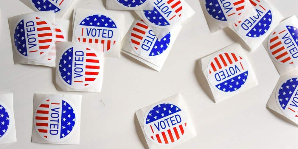 """I voted"" stickers against a white backdrop"