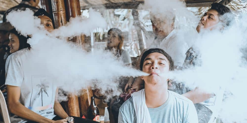 a group of people vapes together socially