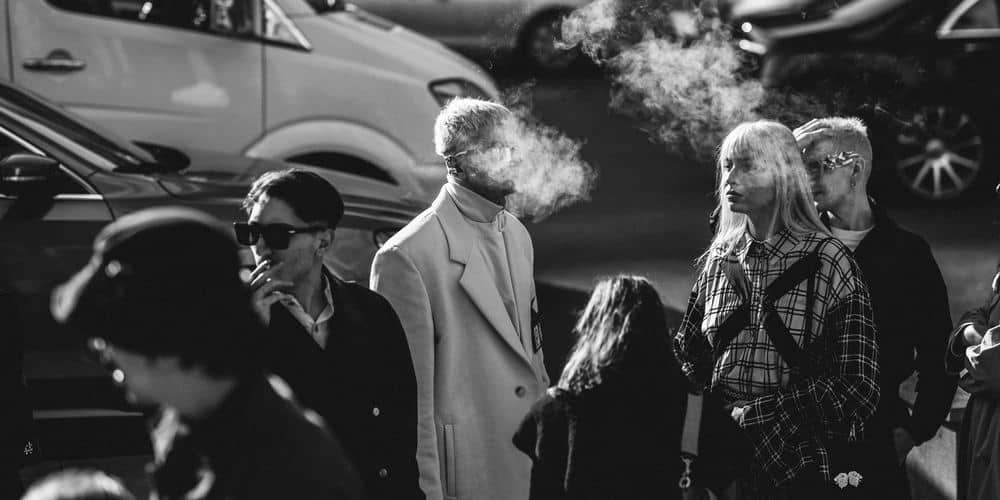 people smoking and vaping in a crowd